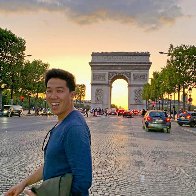 Aric in front of the Arc de Triomphe